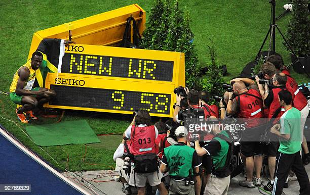 Jamaica's Usain Bolt celebrates winning the men's 100m final race of the 2009 IAAF Athletics World Championships ahead of US Tyson Gay on August 16...
