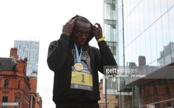 Jamaica's Usain Bolt celebrates with his Gold medal after winning the 150m Event during the BUPA Great Manchester Run and Great City Games in...
