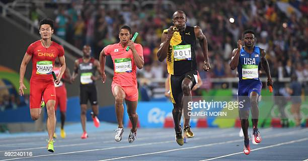 TOPSHOT Jamaica's Usain Bolt competes with China's Zhang Peimeng Japan's Aska Cambridge and USA's Trayvon Bromell in the Men's 4x100m Relay Final...