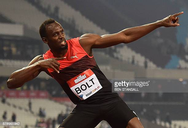 Jamaica's Usain Bolt creates his 'Lightening Bolt' pose as he celebrates winning the men's 200m at the IAAF Diamond League Anniversary Games...