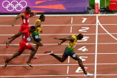 Jamaica's Usain Bolt crosses the finish line to win the men's 100m final at the athletics event during the London 2012 Olympic Games on August 5 2012...