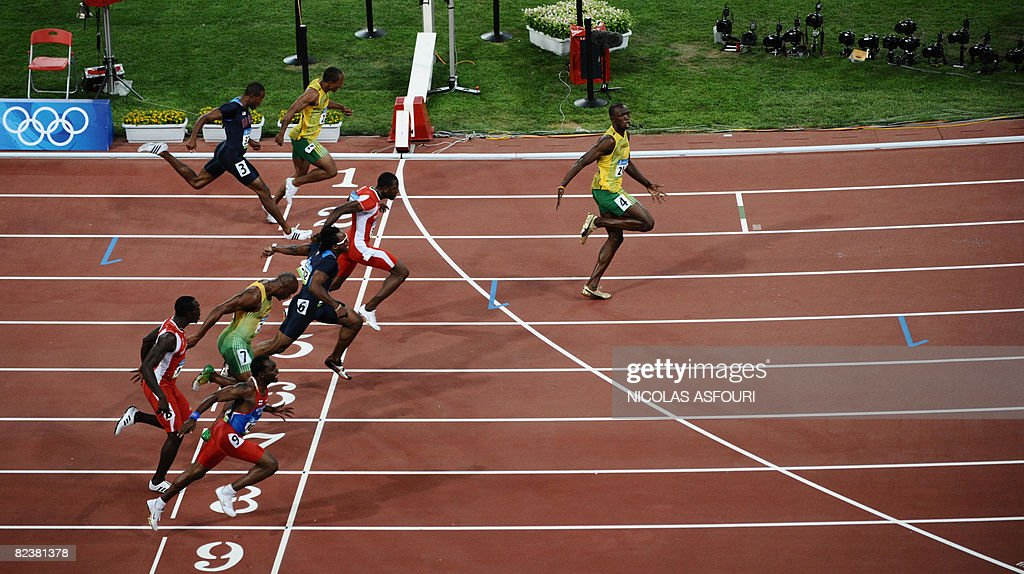 Jamaica's Usain Bolt crosses the finish line to win the men's 100m final at the National stadium as part of the 2008 Beijing Olympic Games on August 16, 2008. Jamaica's Usain Bolt won ahead of Trinidad and Tobago's Richard Thompson and Walter Dix of the US.