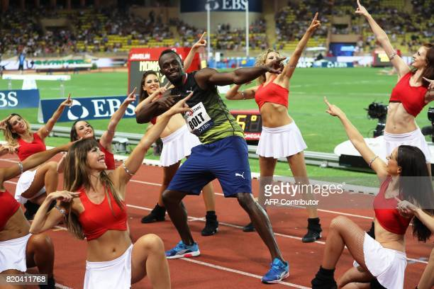 TOPSHOT Jamaica's Usain Bolt dances with pompom girls as he celebrates winning the men's 100m event at the IAAF Diamond League athletics meeting in...