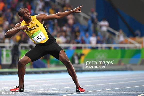 TOPSHOT Jamaica's Usain Bolt does his 'Lightening Bolt'pose after he won the Men's 200m Final during the athletics event at the Rio 2016 Olympic...