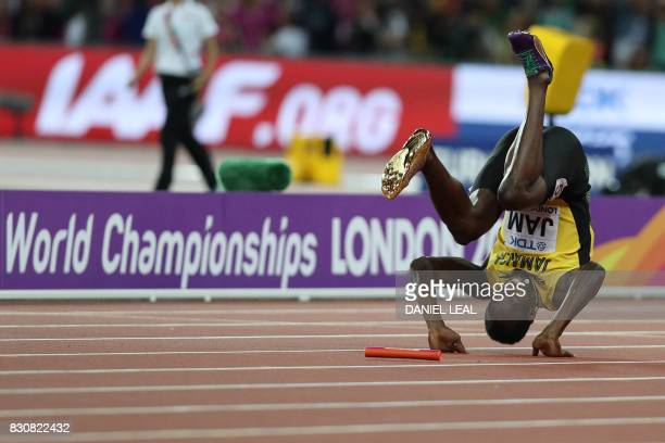 TOPSHOT Jamaica's Usain Bolt falls after hurting himself during the final of the men's 4x100m relay athletics event at the 2017 IAAF World...