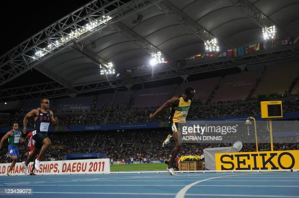 Jamaica's Usain Bolt finishes first ahead of US athlete Walter Dix in the men's 200 metres final at the International Association of Athletics...
