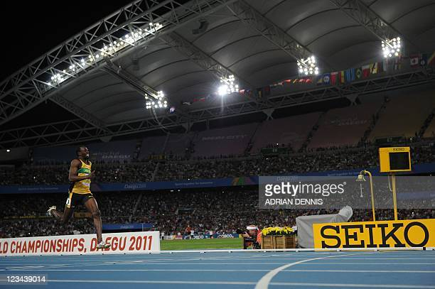 Jamaica's Usain Bolt finishes first in the men's 200 metres final at the International Association of Athletics Federations World Championships in...