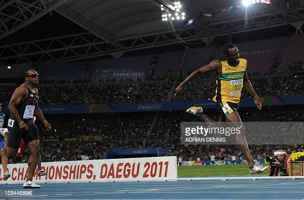 Jamaica's Usain Bolt finishes first to win gold in the men's 200 metres final at the International Association of Athletics Federations World...