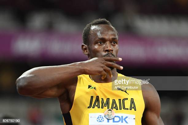 Jamaica's Usain Bolt gestures after placing third in the final of the men's 100m athletics event at the 2017 IAAF World Championships at the London...
