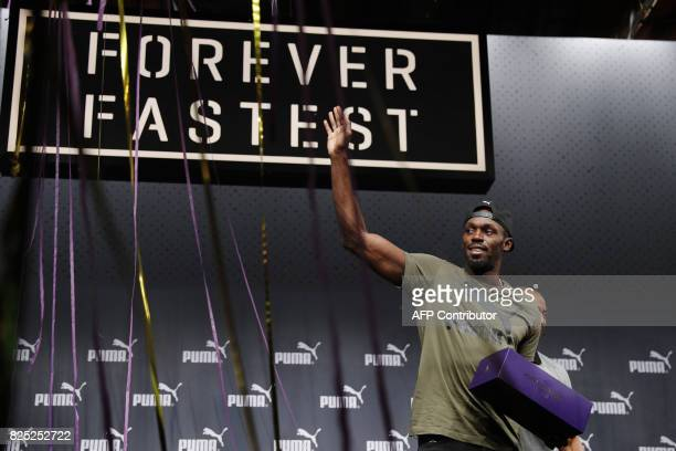 Jamaica's Usain Bolt gestures during a press conference prior to Bolt's last World Championship in east London on August 1 2017 / AFP PHOTO / Adrian...