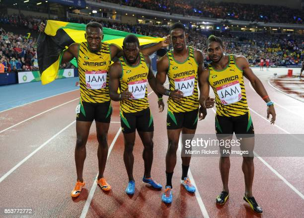 Jamaica's Usain Bolt Nickel Ashmeade Kemar Bailey Cole and Jason Livermore celebrate winning the Men's 4x100m Relay at Hampden Park during the 2014...