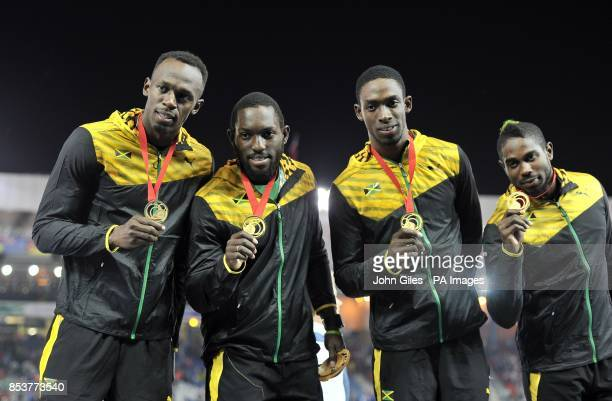Jamaica's Usain Bolt Nickel Ashmeade Kemar Bailey Cole and Jason Livermore with their gold medals for the Men's 4x100m relay at Hampden Park during...