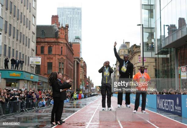 Jamaica's Usain Bolt on the podium celebrates winning the 150m Event during the BUPA Great Manchester Run and Great City Games in Manchester