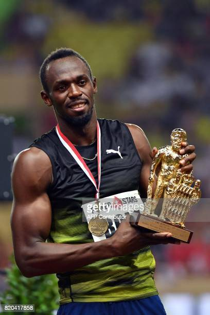 Jamaica's Usain Bolt poses with his trophy after winning the men's 100m event at the IAAF Diamond League athletics meeting in Monaco on July 21 2017...