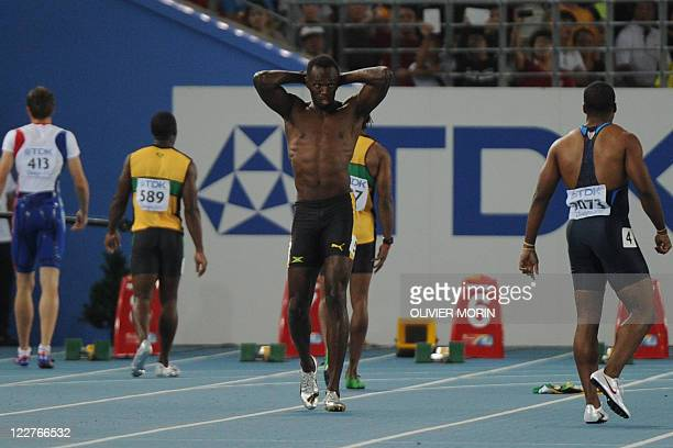 Jamaica's Usain Bolt reacts after making a false start in the final of the men's 100 metres at The International Association of Athletics Federations...