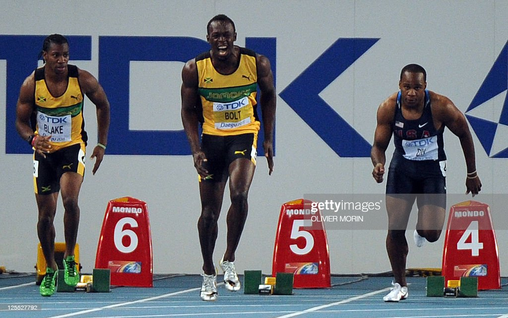 Jamaica's Usain Bolt reacts as the race judge stops the competitors after a false start in the men's 100 metres final at the International...