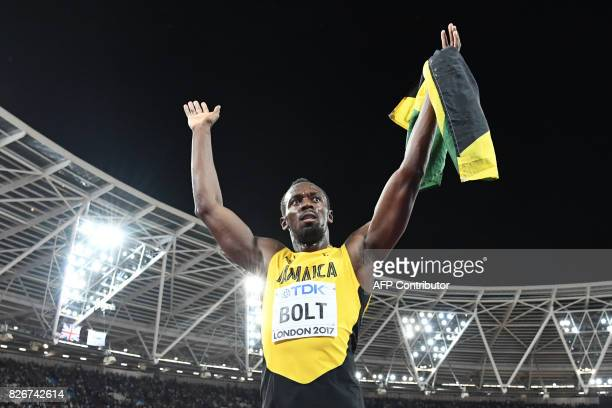 TOPSHOT Jamaica's Usain Bolt receives applause after placing third in the men's 100m athletics event at the 2017 IAAF World Championships at the...