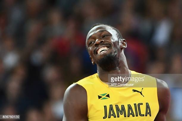 Jamaica's Usain Bolt smiles after placing third in the final of the men's 100m athletics event at the 2017 IAAF World Championships at the London...