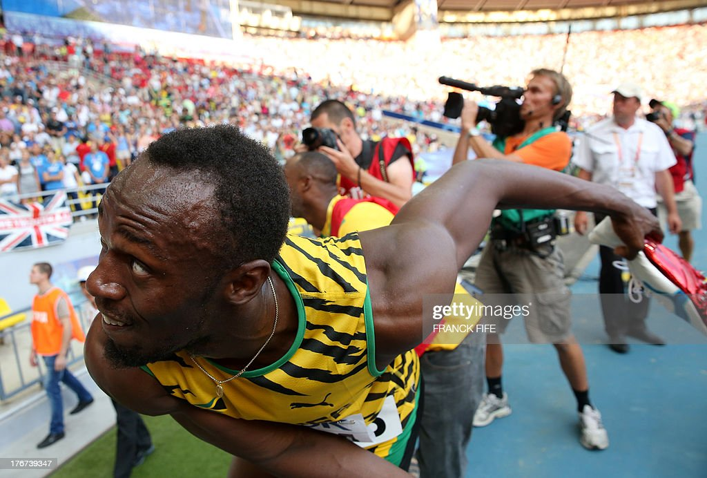 Jamaica's Usain Bolt throws his shoes after winning the men's 4x100 metres relay final at the 2013 IAAF World Championships at the Luzhniki stadium in Moscow on August 18, 2013.