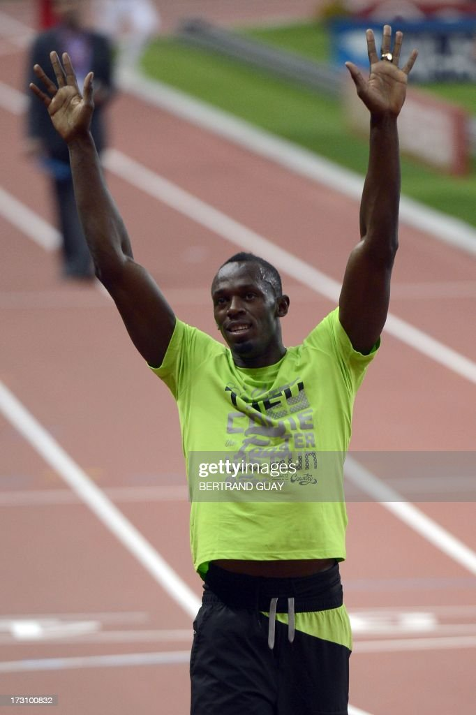 Jamaica's Usain Bolt waves after the men's 200m at the IAAF Diamond League athletics meeting in Saint-Denis, near Paris, on July 6, 2013.