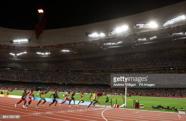 Jamaica's Usain Bolt wins the gold medal and breaks the world 100m record at the National Stadium during the 2008 Beijing Olympics in China