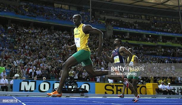 Jamaica's Usain Bolt wins the men's 100m final race of the 2009 IAAF Athletics World Championships ahead of US Tyson Gay and Jamaica's Asafa Powell...