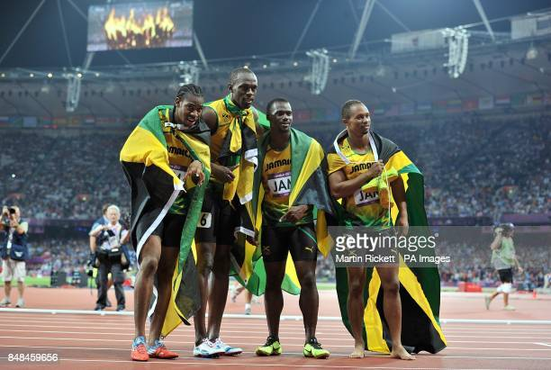 Jamaica's Usain Bolt Yohan Blake Nesta Carter and Michael Frater celebrate after setting a new World Record in the Men's 4 x 100m Relay Final during...