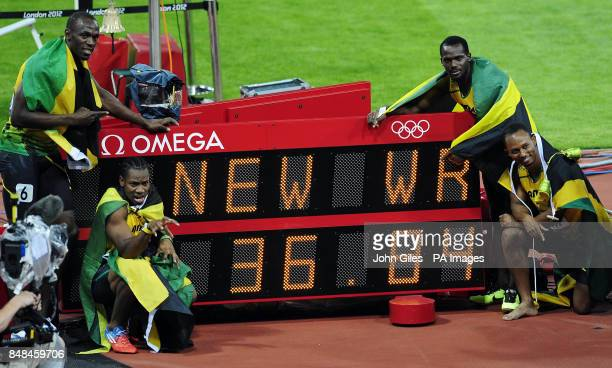 Jamaica's Usain Bolt Yohan Blake Nesta Carter and Michael Frater celebrate winning the Men's 4x100m Relay with a world record time on day fifteen of...