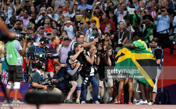 Jamaica's Warren Weir Usain Bolt and Yohan Blake celebrate in front of the cameras after the Men's 200m Final at the Olympic Stadium London