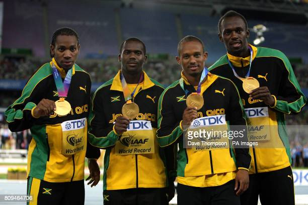 Jamaica's Yohan Blake Nesta Carter Michael Frater and Usain Bolt pose with their gold medals during the medal ceremony for the Men's 4x100m relay