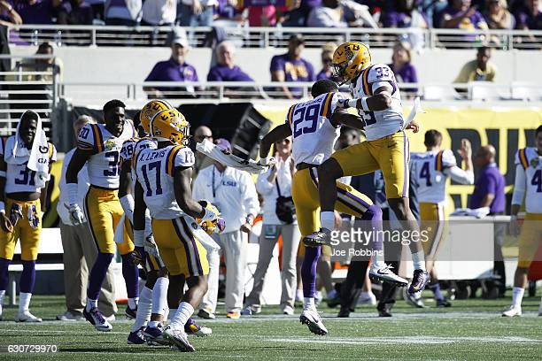 Jamal Adams of the LSU Tigers celebrates with teammates after a defensive stop against the Louisville Cardinals in the fourth quarter of the Buffalo...