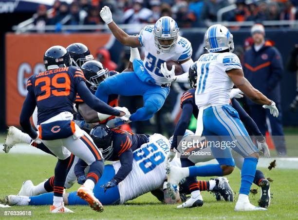 Jamal Agnew of the Detroit Lions jumps over players while carrying the football in the third quarter against the Chicago Bears at Soldier Field on...