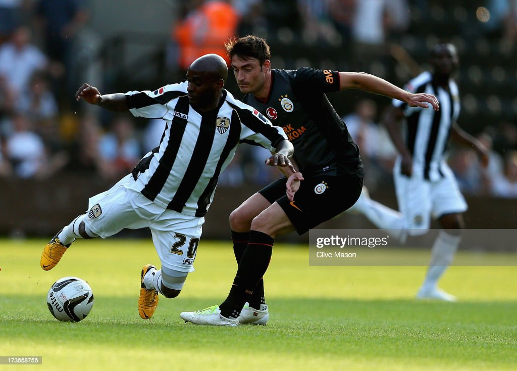 Jamal Campbell-Ryce of Notts County is tackled by Albert Riera of Galatasaray during the pre season friendly match between Notts County and Galatasaray at Meadow Lane on July 16, 2013 in Nottingham, England.