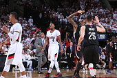 Jamal Crawford and Austin Rivers of the Los Angeles Clippers celebrates against the Portland Trail Blazers in Game Three of the Western Conference...
