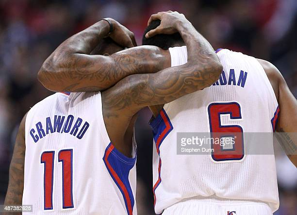 Jamal Crawford and DeAndre Jordan of the Los Angeles Clippers embrace during the final minute against the Golden State Warriors in Game Five of the...