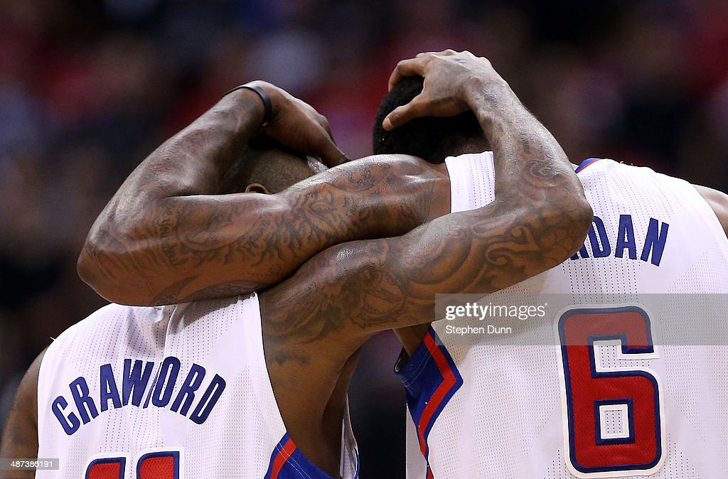 Jamal Crawford #11 and DeAndre Jordan #6 of the Los Angeles Clippers embrace during the final minute against the Golden State Warriors in Game Five of the Western Conference Quarterfinals during the 2014 NBA Playoffs at Staples Center on April 29, 2014 in Los Angeles, California. The Clippers won 113-103.