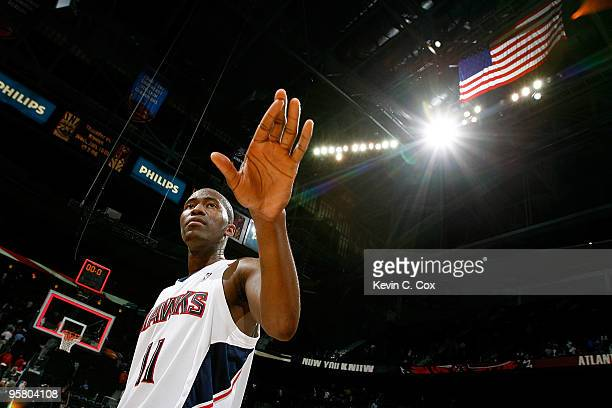 Jamal Crawford of the Atlanta Hawks celebrates after hitting a gamewinning threepoint basket against the Phoenix Suns at Philips Arena on January 15...