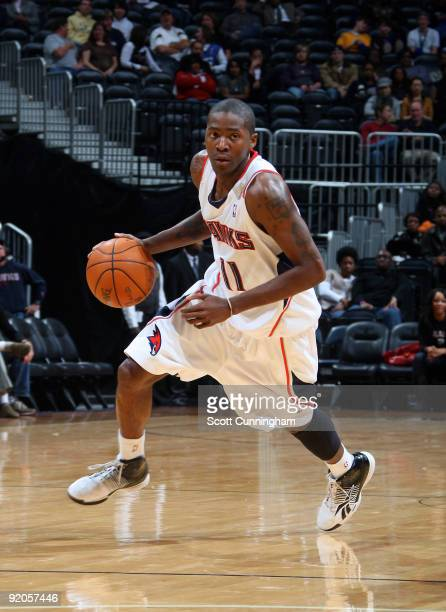 Jamal Crawford of the Atlanta Hawks drives against the Washington Wizards during a preseason game on October 19 2009 at Philips Arena in Atlanta...