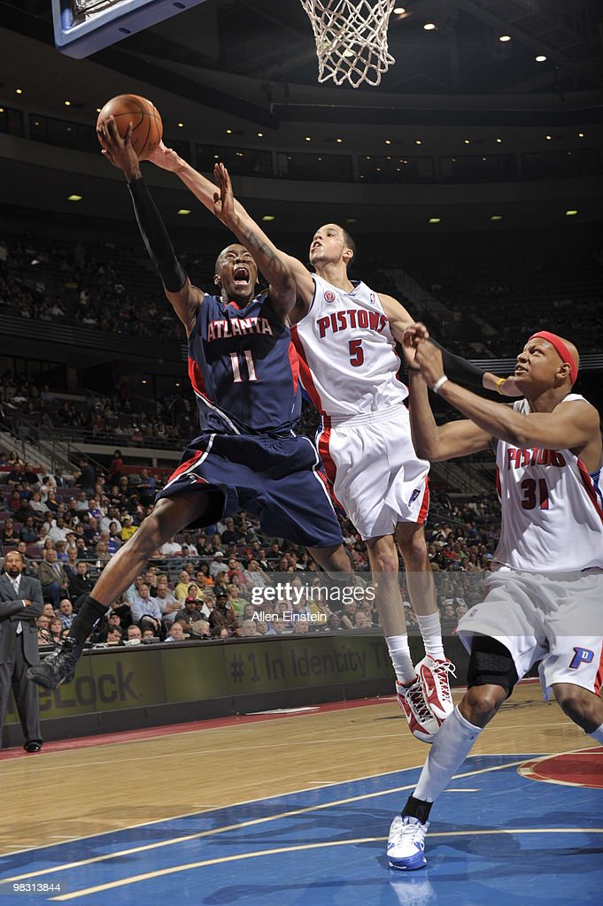 Jamal Crawford of the Atlanta Hawks goes up for a shot attempt against Austin Daye of the Detroit Pistons in a game at the Palace of Auburn Hills on...