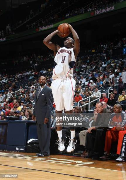 Jamal Crawford of the Atlanta Hawks puts up a 3point shot against the New Orleans Hornets during a preseason game on October 7 2009 at Philips Arena...