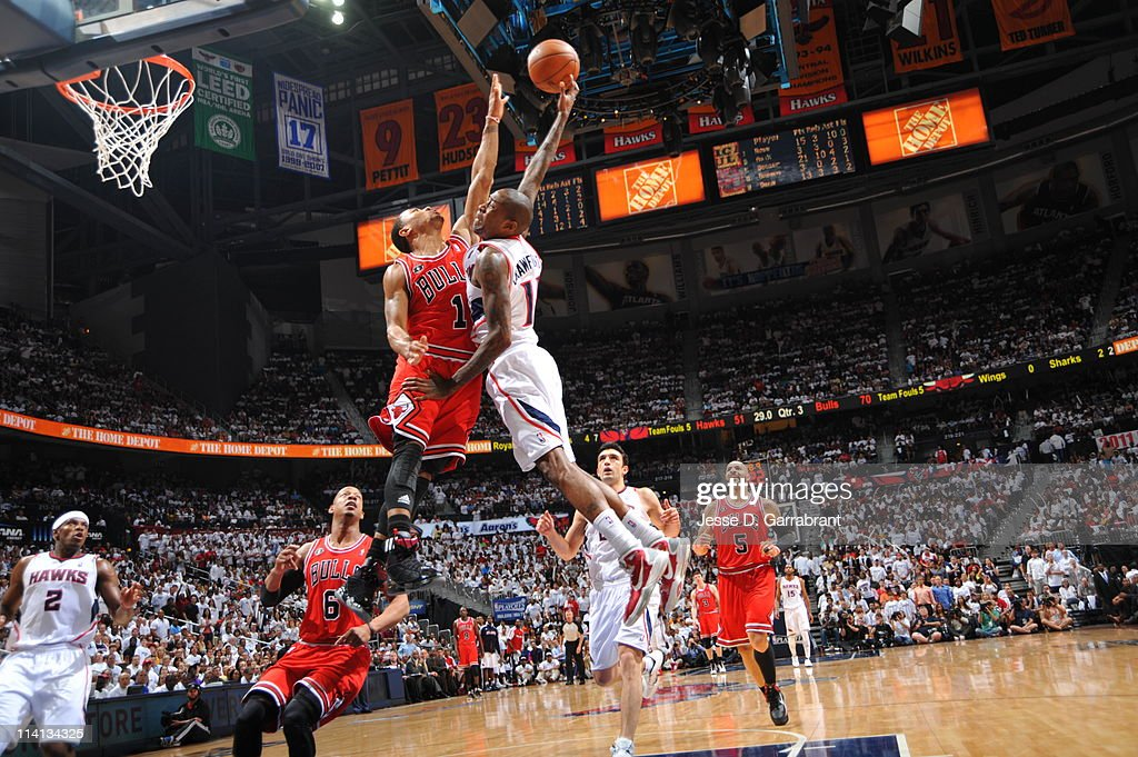 Jamal Crawford #11 of the Atlanta Hawks shoots against Derrick Rose #1 of the Chicago Bulls during Game Six of the Eastern Conference Semifinals in the 2011 NBA Playoffs on May 12, 2011 at Phillips Arena in Atlanta, Georgia.
