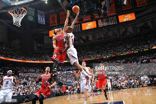 Jamal Crawford of the Atlanta Hawks shoots against Derrick Rose of the Chicago Bulls during Game Six of the Eastern Conference Semifinals in the 2011...