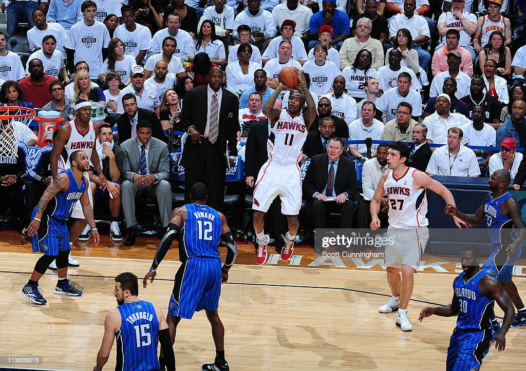 <a gi-track='captionPersonalityLinkClicked' href=/galleries/search?phrase=Jamal+Crawford&family=editorial&specificpeople=201851 ng-click='$event.stopPropagation()'>Jamal Crawford</a> #11 of the Atlanta Hawks shoots against <a gi-track='captionPersonalityLinkClicked' href=/galleries/search?phrase=Dwight+Howard&family=editorial&specificpeople=201570 ng-click='$event.stopPropagation()'>Dwight Howard</a> #12 of the Orlando Magic in Game Three of the Eastern Conference Quarterfinals in the 2011 NBA Playoffs on April 22, 2011 at Philips Arena in Atlanta, Georgia.