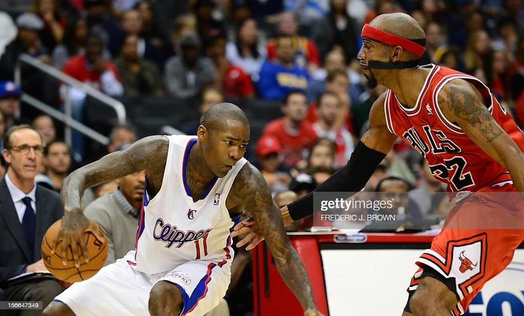 Jamal Crawford of the LA Clippers (L) dribbles under pressure from Taj Gibson (R) of the Chicago Bulls during their game on November 17, 2012 at Staples Center in Los Angeles, California. AFP PHOTO / Frederic J. BROWN