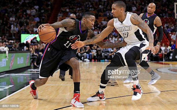 Jamal Crawford of the LA Clippers drives on Rodney McGruder of the Miami Heat during a game at American Airlines Arena on December 16 2016 in Miami...