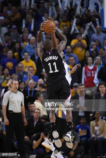 Jamal Crawford of the LA Clippers shoots the ball over Kevin Durant of the Golden State Warriors during an NBA basketball game at ORACLE Arena on...