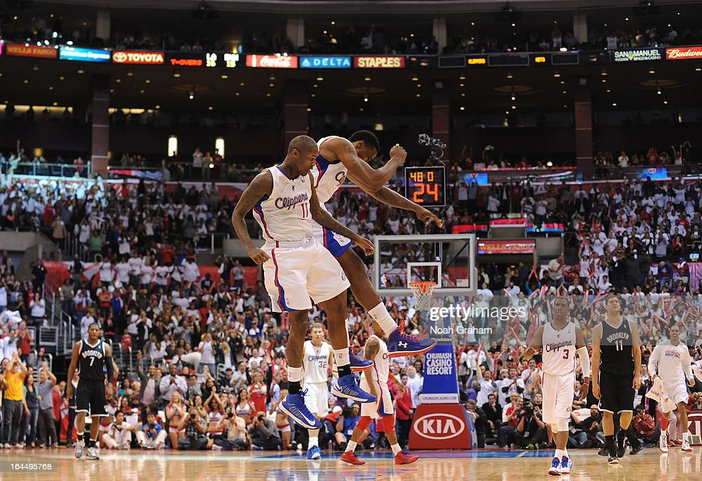 Jamal Crawford #11 of the Los Angeles Clippers and DeAndre Jordan #6 of the Los Angeles Clippers celebrate during the game between the Los Angeles Clippers and the Brooklyn Nets at Staples Center on March 23, 2013 in Los Angeles, California.