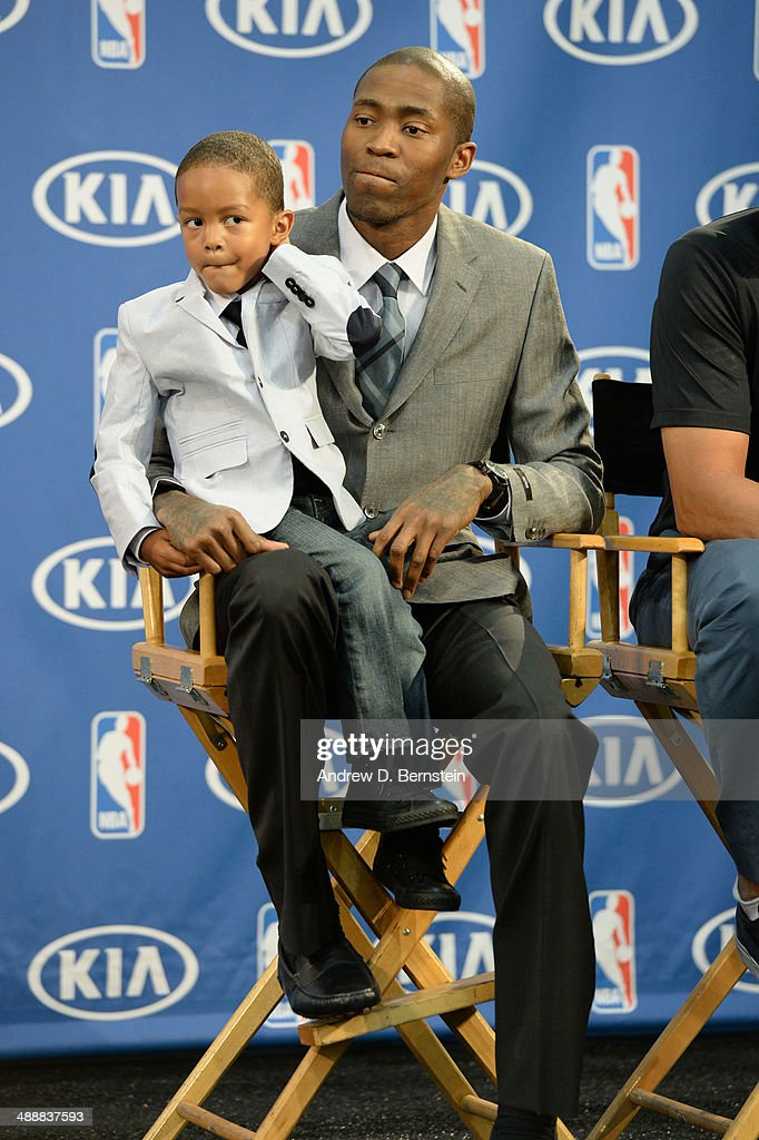 Jamal Crawford #11 of the Los Angeles Clippers and his son sit during the Sixth Man Award Press Conference at the Los Angeles Clippers Training Facility on May 8, 2014 in Playa Vista, California.