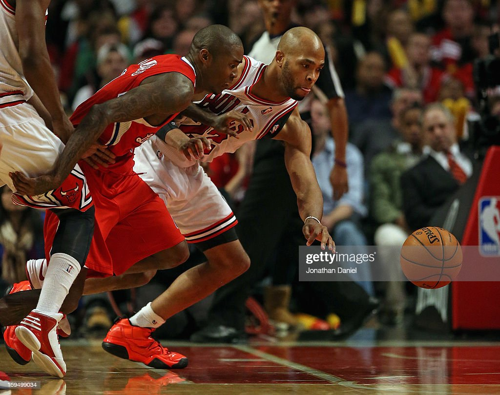 Jamal Crawford #11 of the Los Angeles Clippers and Taj Gibson #22 of the Chicago Bulls chase a loose ball at the United Center on December 11, 2012 in Chicago, Illinois. The Clippers defeated the Bulls 94-89.