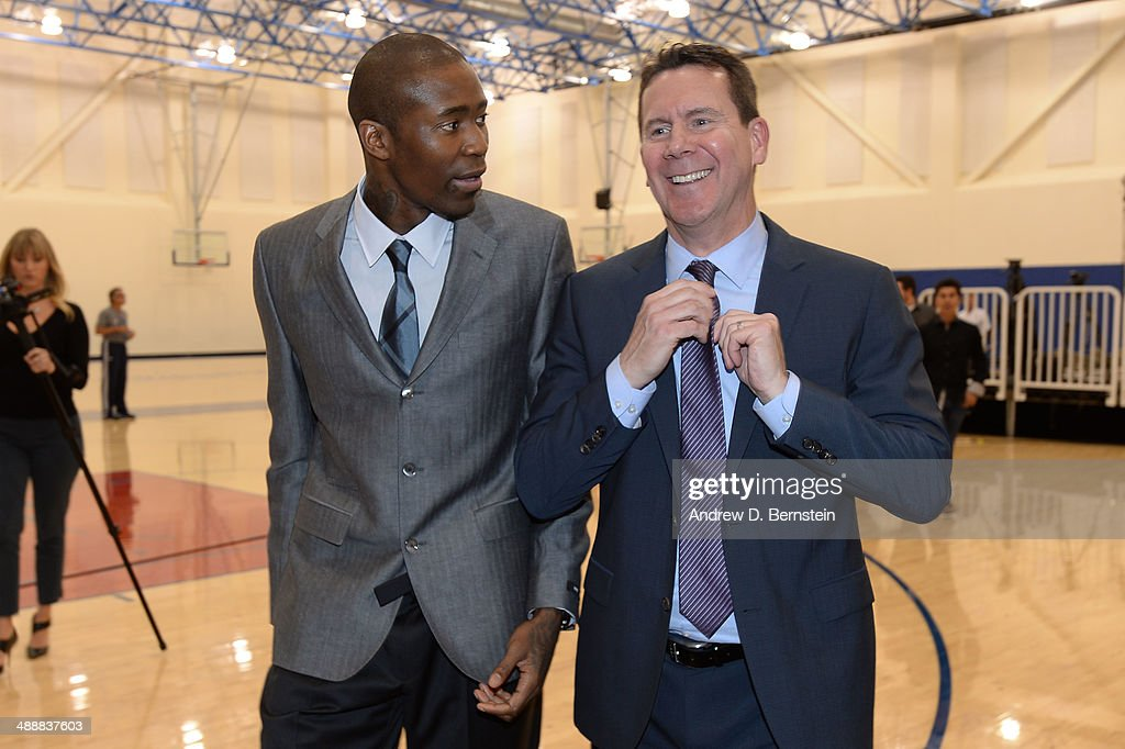 Jamal Crawford #11 of the Los Angeles Clippers and Tim Chaney of Kia Motors converse after the Jamal Crawford Sixth Man Award Press Conference at the Los Angeles Clippers Training Facility on May 8, 2014 in Playa Vista, California.